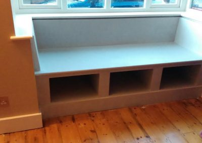 contemporary fitted window seat with storage